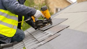 Roofer,Worker,In,Special,Protective,Work,Wear,And,Gloves,,Using